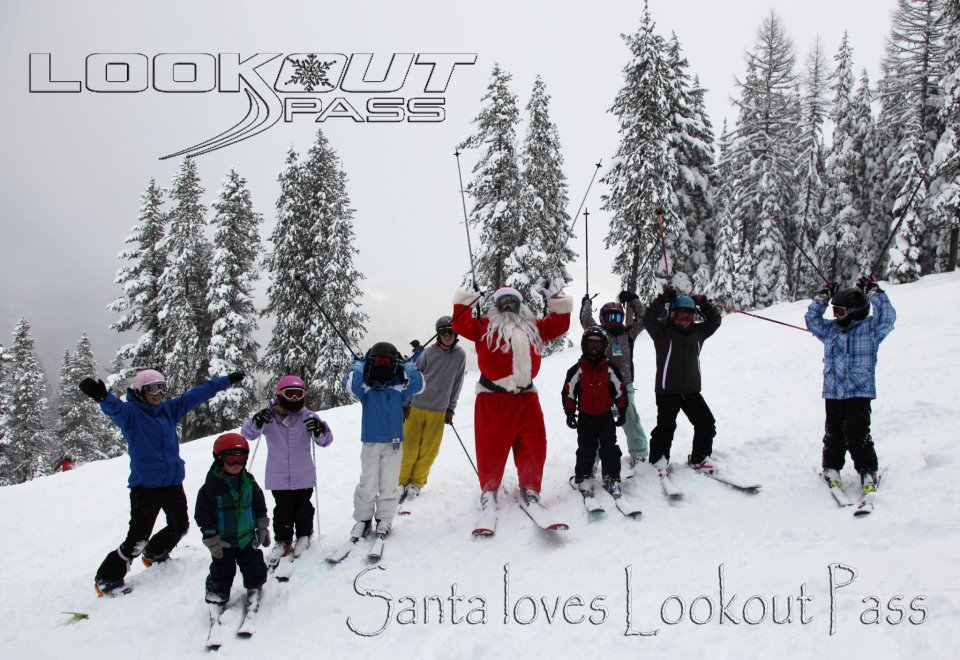 "Santa skiing with a group of kids; ""Santa loves Lookout Pass!"""