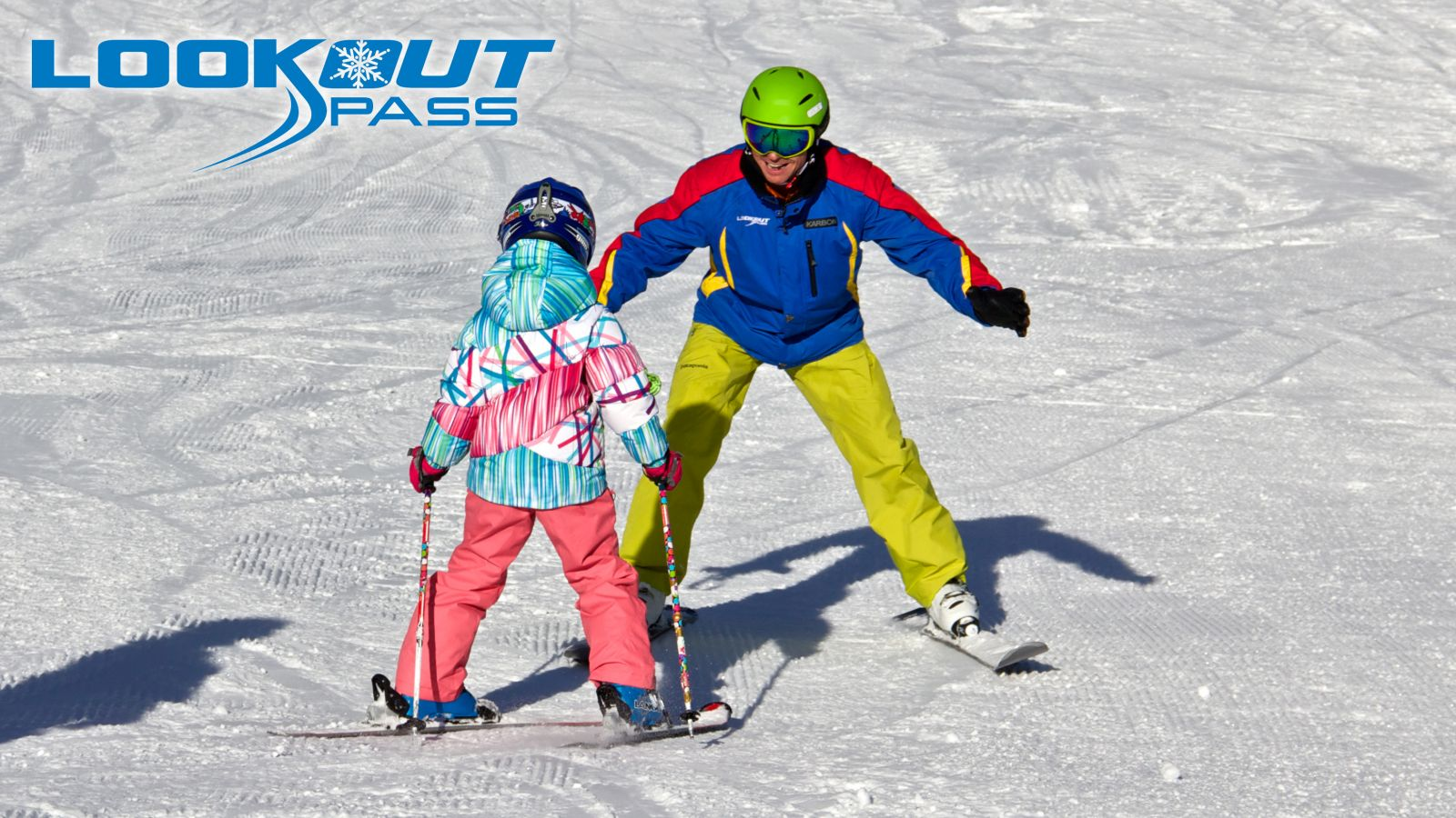 Instructor teaching girl how to ski at Lookout Pass