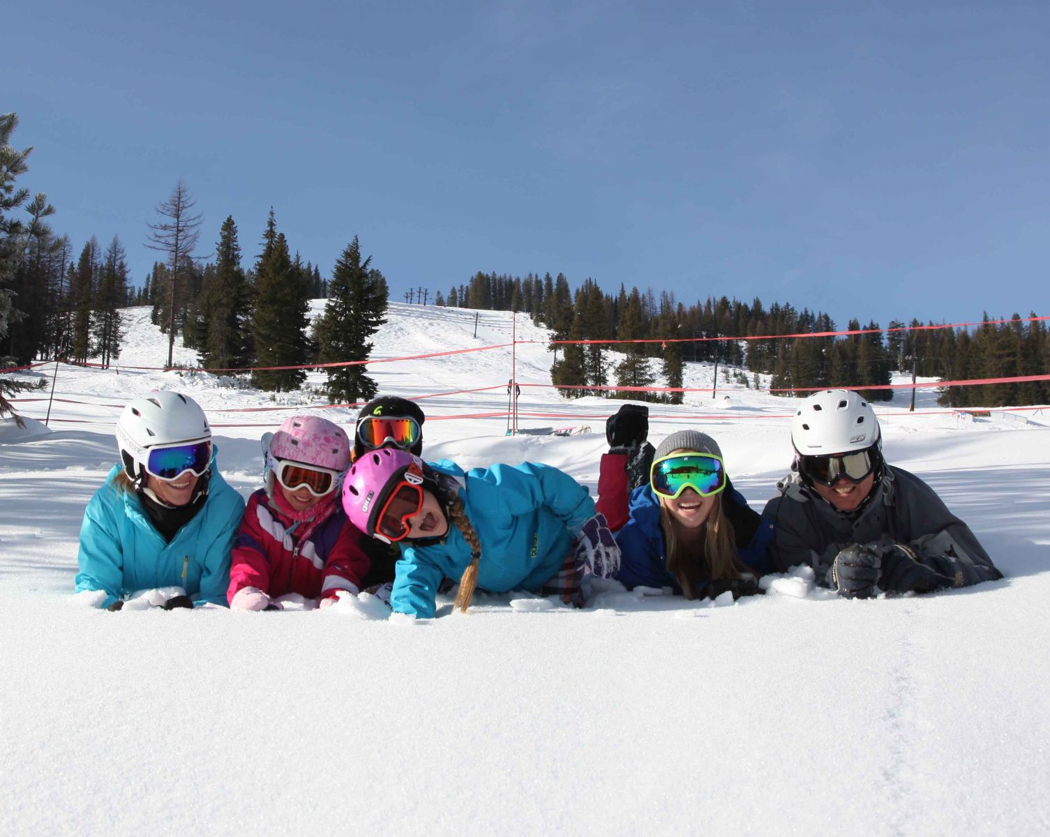 Kids and families playing in the snow at Lookout Pass
