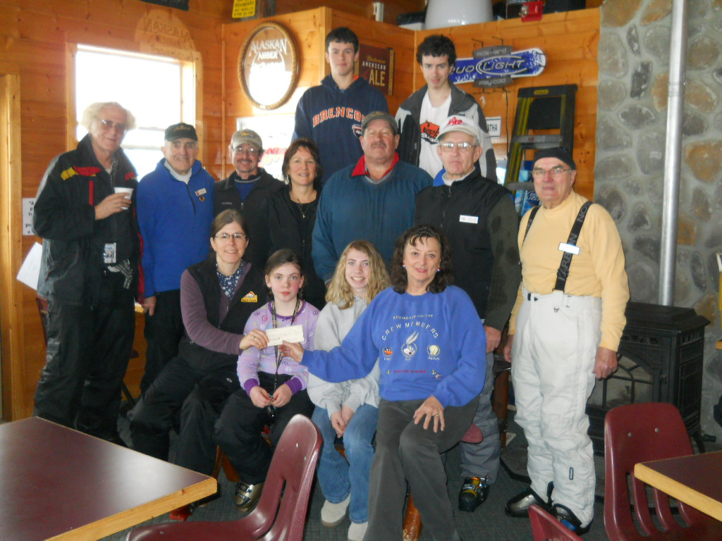 Group in the lodge after the junior ski donation event